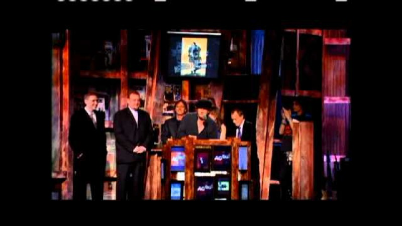AC DC accepts award Rock and Roll Hall of Fame inductions 2003