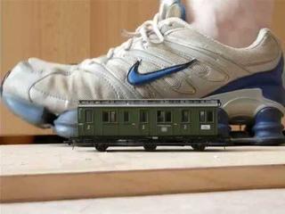 Nike ShoxTL crush a model train car