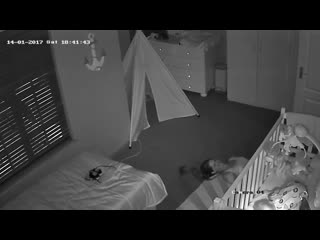 Mother tries to slide out of babies room