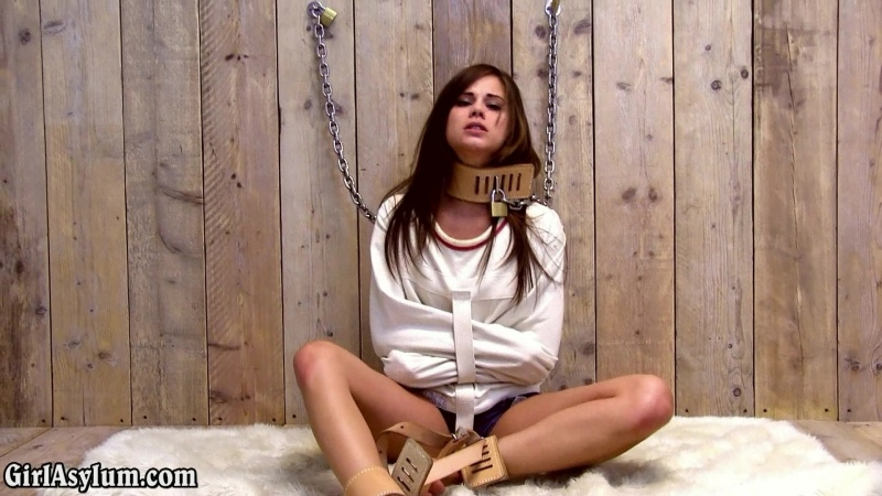 Little Caprice chained to the wall