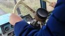 Катя учиться заводить трактор. Едем колоть дрова.